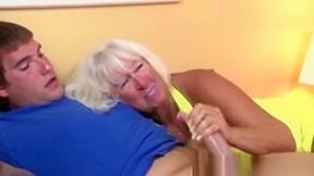 Handjob loving granny tugging hard dick...