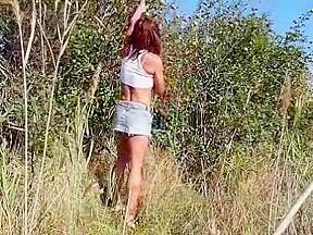 Sexy crossdresser playing outdoor...