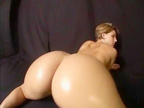 Shaking her huge oiled ass...