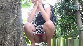 Nerdy asian cocktease kneels for pissing behind tree...