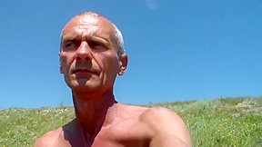 Amateur shows old dude posing in the outdoors...
