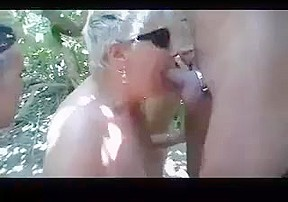 Granny at the beach engulfing every cock she...