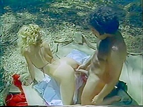 Ron jeremy on a beach in the eigthies...