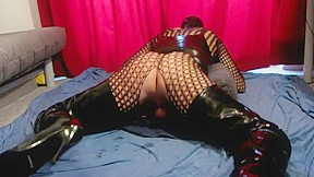 Crossdresser latex and crotch boots fucking his ass...