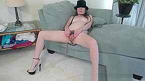 Ophelia jones strips wearing a black hat and...