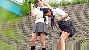 Outside pissing competition with two young japanese pupils...