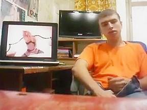 Russian guy jerking watching porn...