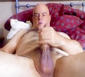 Bear with stroking his long dick...