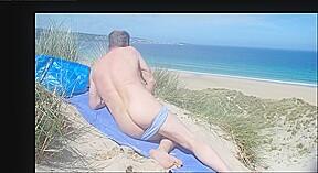 Male nudist spied massaging his butt genitals dunes...