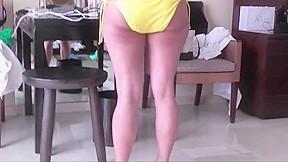 Tries on her bikinis...