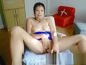 Horny fucks herself with a dildo...