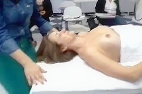 Class with topless woman...