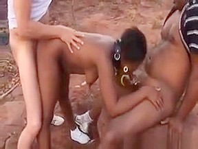 African slut fucked in outdoor action by two...