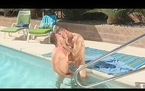 Two muscle men fuck by the pool...