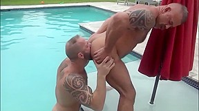 Strong muscular by the garden pool...