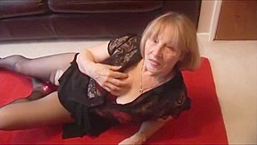 Busty blonde granny rips pantyhose to show off...