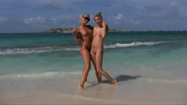 Nude women playing on the beach