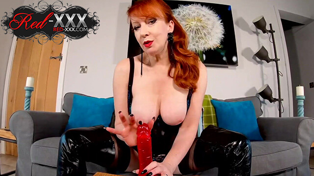 Insatiable mature Red XXX has a new toy to play with