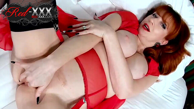 Busty British mature Red XXX is all alone and horny